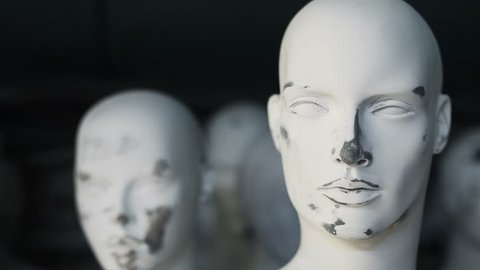 White scary male mannequin face, close up