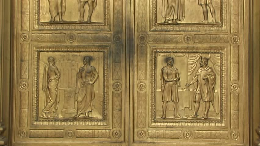 Close view of the historic figures carved into the bronze doors at the west entrance Supreme & Bronze Doors Stock Footage Video | Shutterstock Pezcame.Com