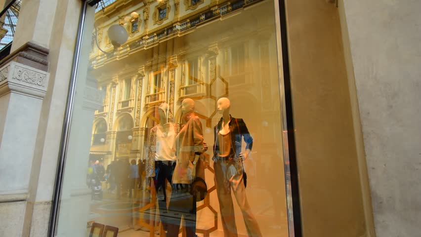 Shop window. Shop in the famous Milan shopping gallery. Mannequins in the transparent shop window. Clothing shop, shop front.