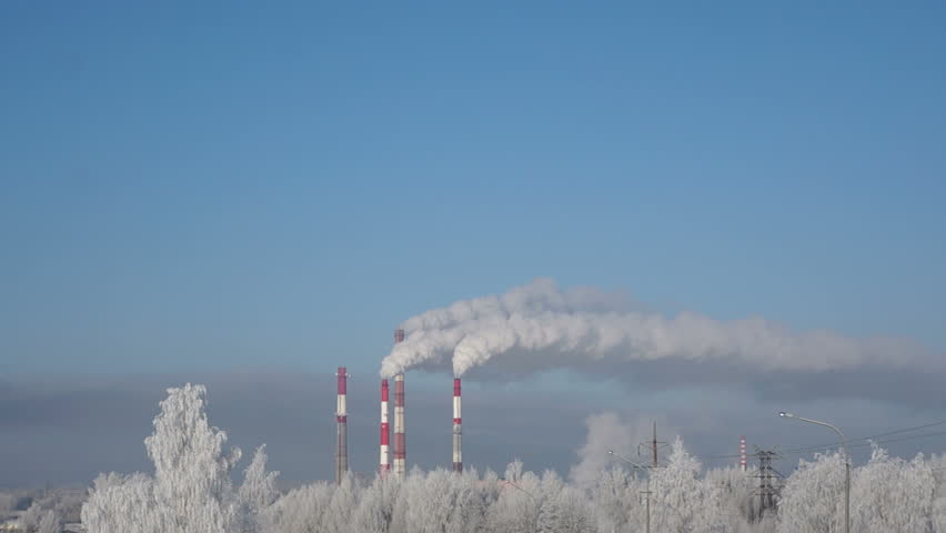 White smoke from the chimneys of factory in the distance | Shutterstock HD Video #15693814