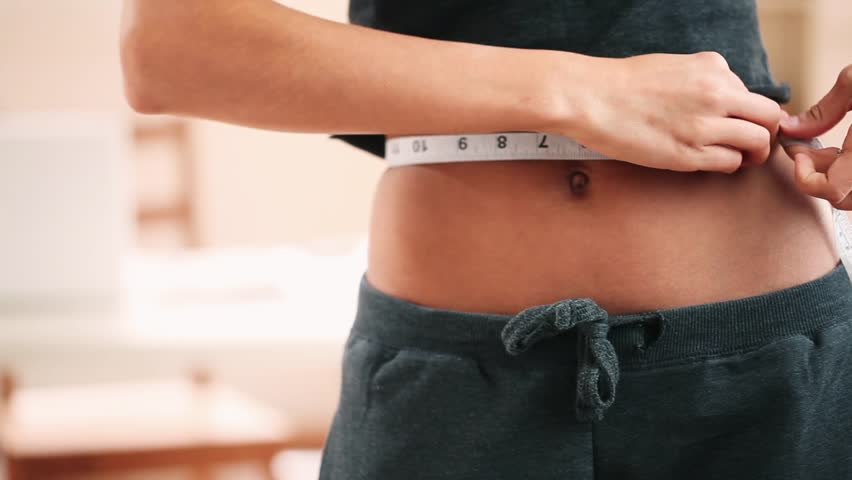 Woman measuring perfect sexy waist