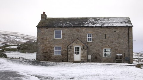 ALSTON, ENGLAND - MAR 2016: North England historic farm house snow Alston. Town in Cumbria in North Pennines Area of Outstanding Natural Beauty. Near historic Hadrians Wall, Roman Epiacum Fort.