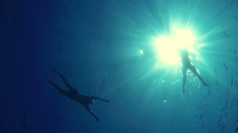 GoPro - Young couple swimming in the sea