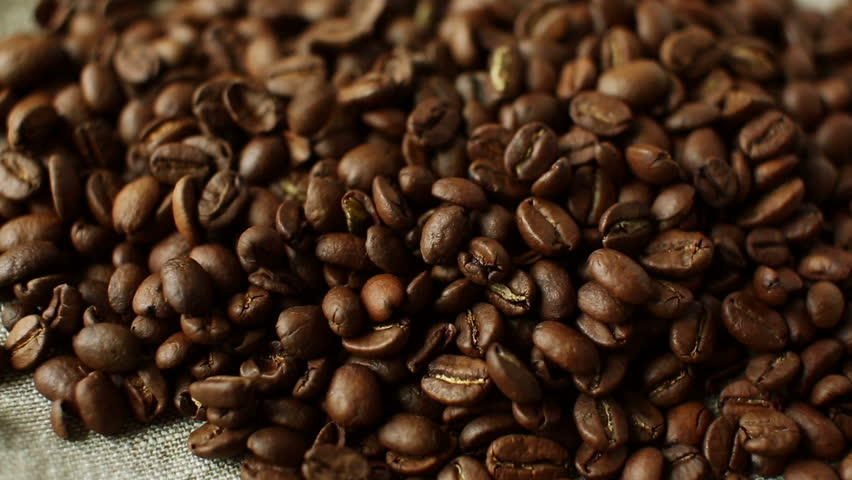 Falling roasted coffee beans on linen tablecloth | Shutterstock HD Video #15754324