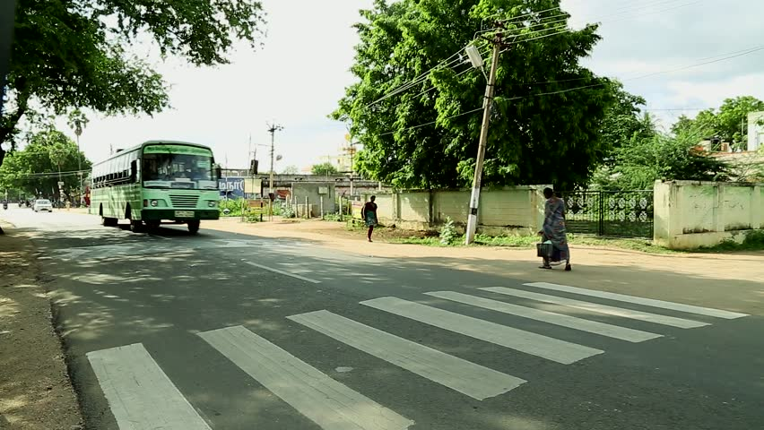 TIRUPPATUR, INDIA - NOVEMBER 15th, 2015: Bus and People crossing the street-India. | Shutterstock HD Video #15767254