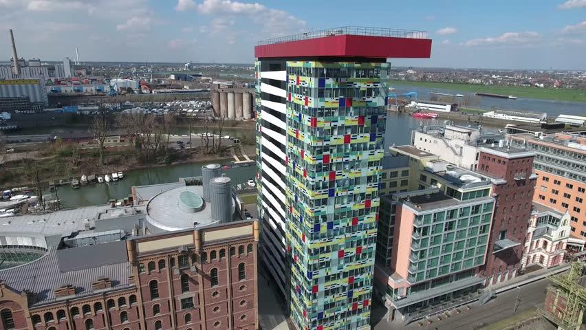 Aerial Flight Duesseldorf NRW Luftaufnahmen Düsseldorf Pan in the middel of Media Harbour several colorful famous Office Buildings - Flug mitten im Medienhafen mit mehreren Bunten hohen Bürogebäuden