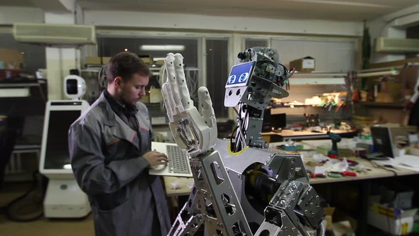 Engineer adjusts the robot