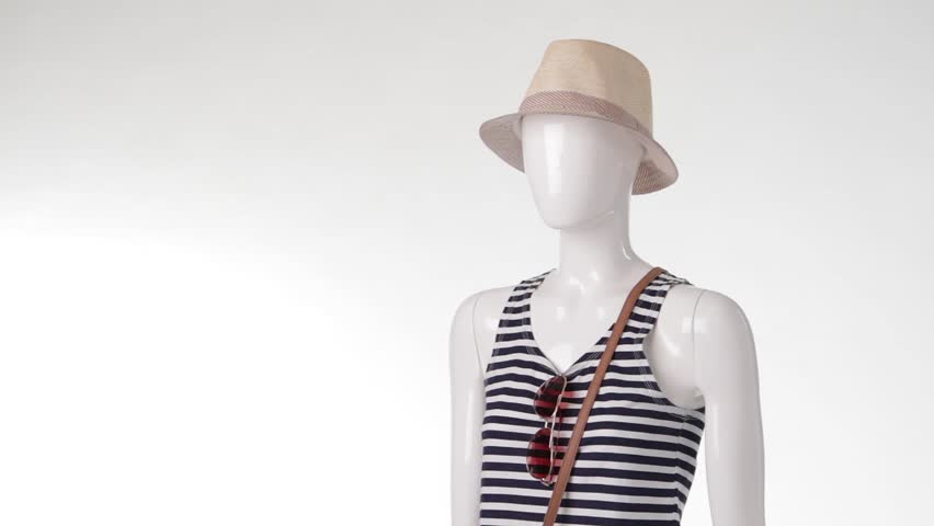 Navy striped top on mannequin. Woman's short denim shorts. Denim shorts with bicolor bag. Casual summer outfit with sunglasses.   Shutterstock HD Video #15803164