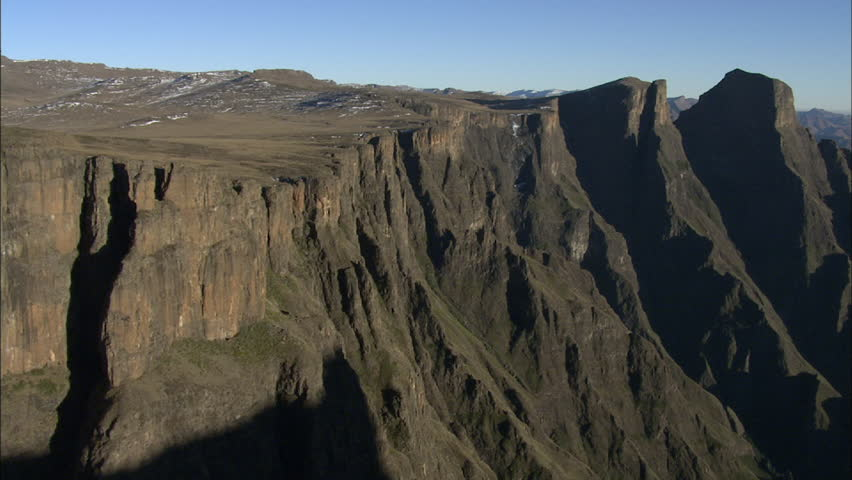 Aerial shot over rugged mountains in the Drakensberg