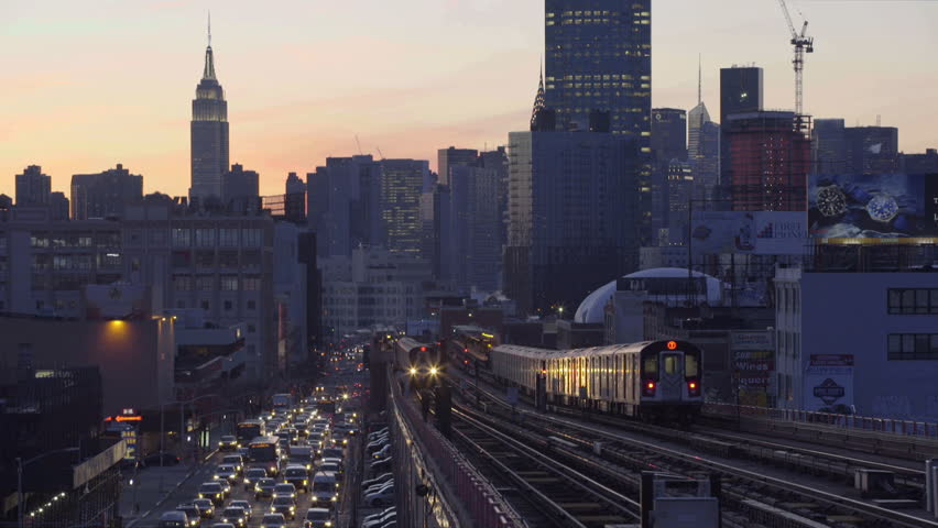 An outbound number 7 train passes through Queens at sunset. New York, NY - March, 2016