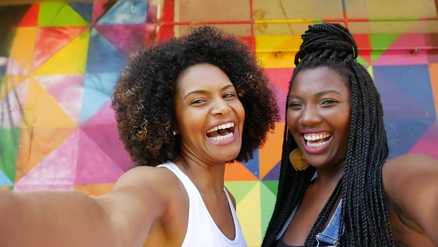 Young Afro Brazilian woman smiling for a selfie | Shutterstock HD Video #15834454