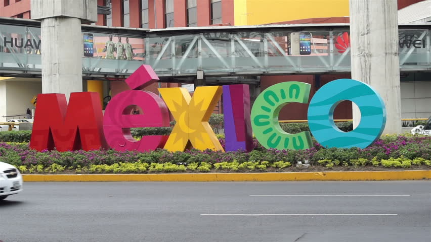 MEXICO CITY, MEXICO - APRIL 11, 2016: Handheld shot of the colorful Mexico sign welcoming visitors outside of the Benito Juarez Mexico City International Airport.