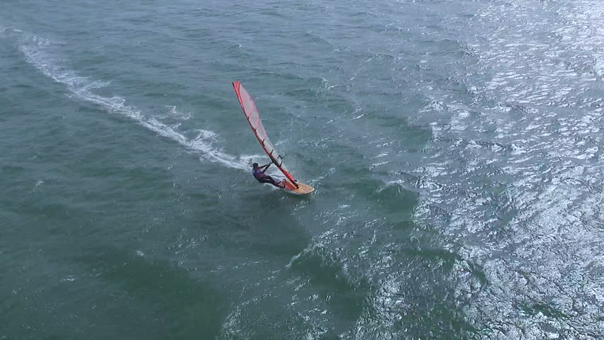 Mui ne, Vietnam - April, 2016: Aerial view of windsurfers sailing on blue sea on Open international competition in Vietnam, CIRCA april, 2016. The great wind made for extreme windsurfing racing.  | Shutterstock HD Video #15852394