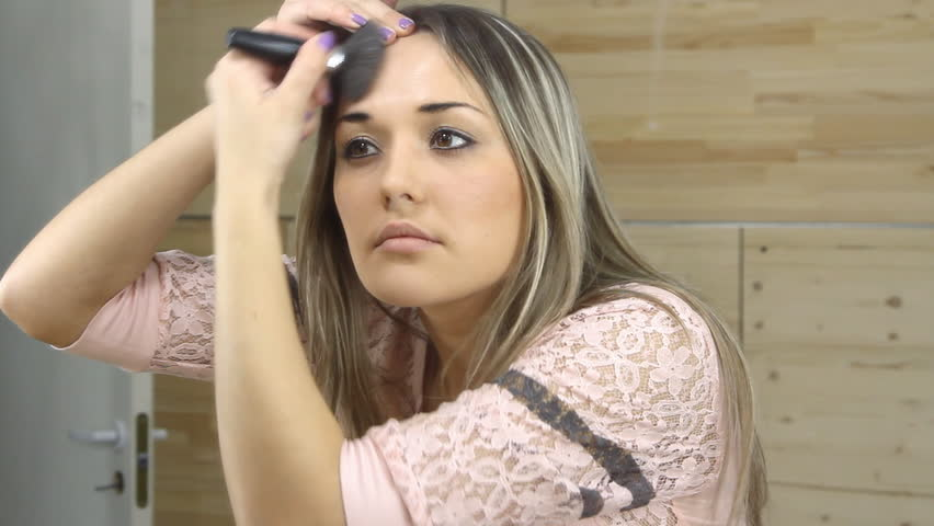 Beautiful girl looking in the mirror and applying cosmetic with a big brush. | Shutterstock HD Video #15856549