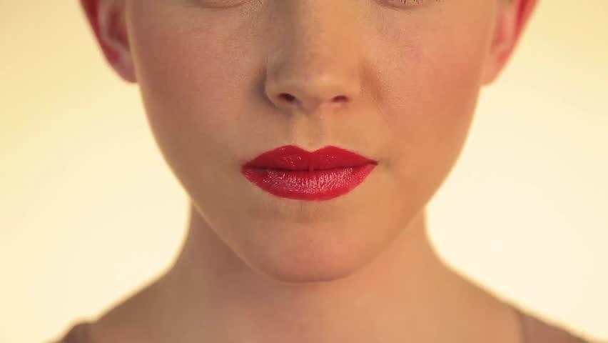 August 02,2012: Woman blowing bubble gum, bubble bursting