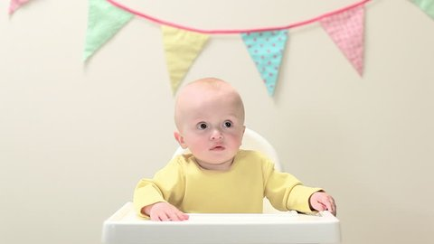 June 02, 2010: Baby boy sitting in highchair with bunting
