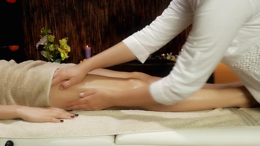 Closeup Of Female Legs Getting Massage In Luxury Spa