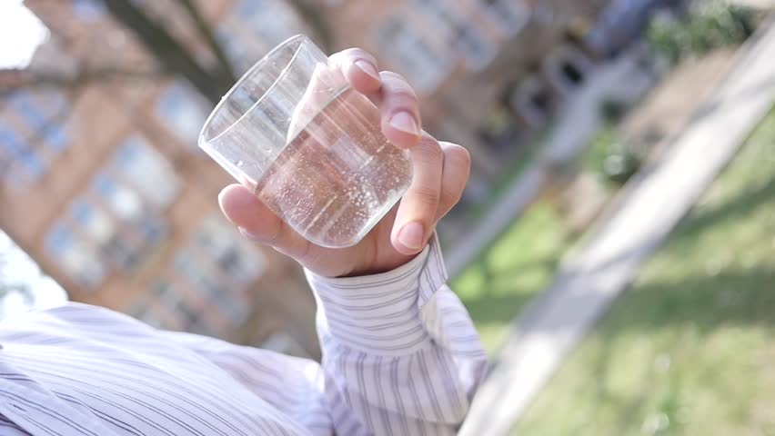 Man drinking clean pure water from a glass outdoors | Shutterstock HD Video #15892624