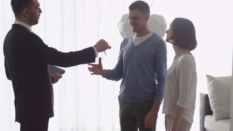Real-estate Agent Shows New Apartments to Couple and Giving the Keys to a Man.  Shot on RED Cinema Camera.