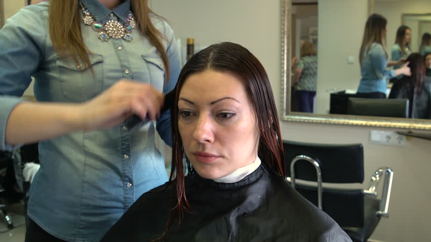 The stylist combing wet hair client | Shutterstock HD Video #15947314