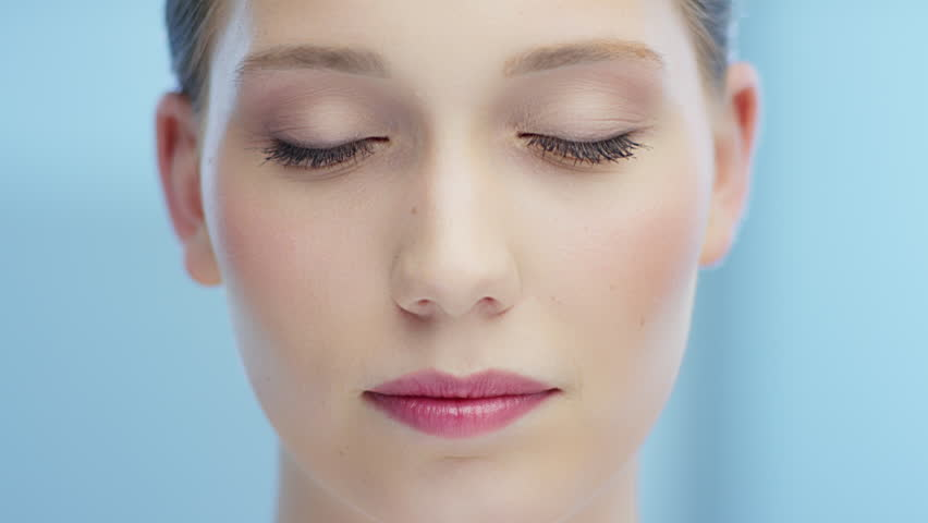 Beautiful young woman open eyes and smiles   Shutterstock HD Video #15961984