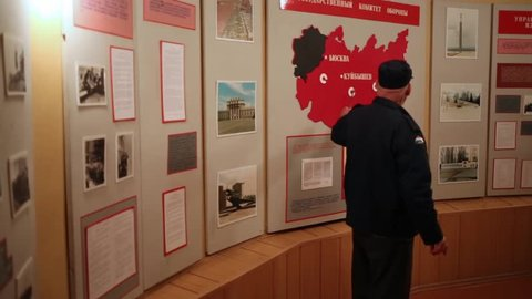 SAMARA - MAY, 8, 2015: Guide showing to boards about Kuibyshev during World War II to people in Stalins bunker in Samara. Virtual Museum of Great Patriotic War will be in Samara.