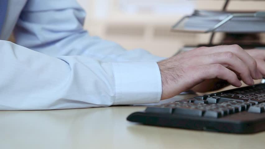 December 04, 2010: Office worker using computer keyboard | Shutterstock HD Video #15976042
