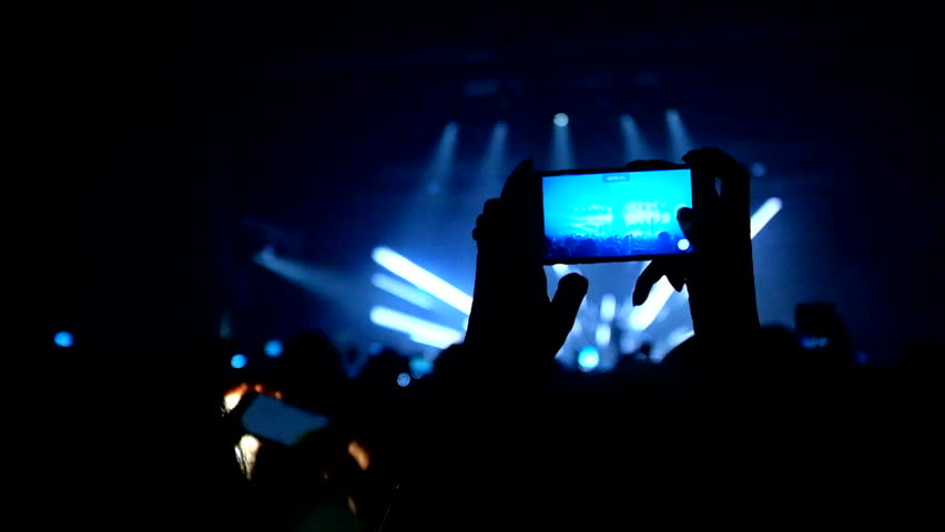 00:02 | 00:22 1Ã?  Fans waving their hands and hold the phone with digital displays the crowd at a rock concert.Here is footage of people crowd partying at a concert or a night club.