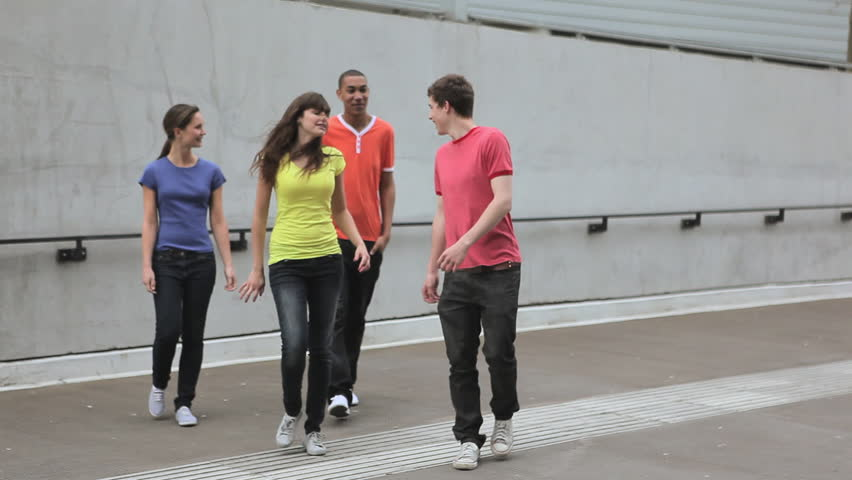 May 18, 2010: Group of young adult friends walking