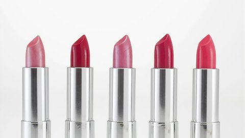 July 25, 2011: Pink and red lipsticks on white background