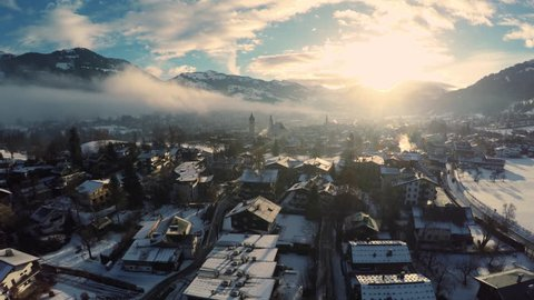 City of Kitzbuehel in winter - Aerial shot at sunrise