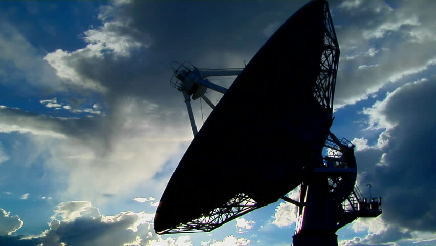 A satellite dish moves in time-lapse and is silhouetted against the sky   Shutterstock HD Video #1603552