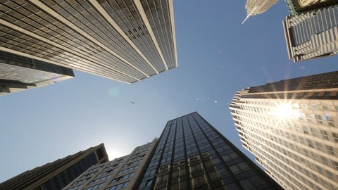 New York City skyscraper buildings driving moving tracking low angle POV dolly