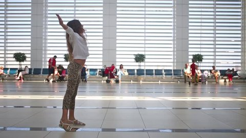 Little girl met her mother in airport with open arms