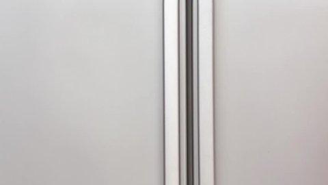 opening door of fridge