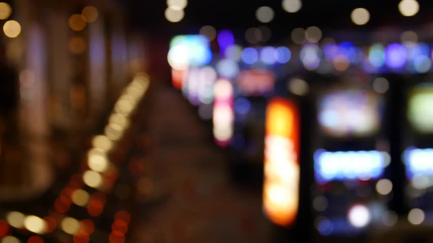 A shot of out of focus lights from a slot machines in a casino | Shutterstock HD Video #16098064
