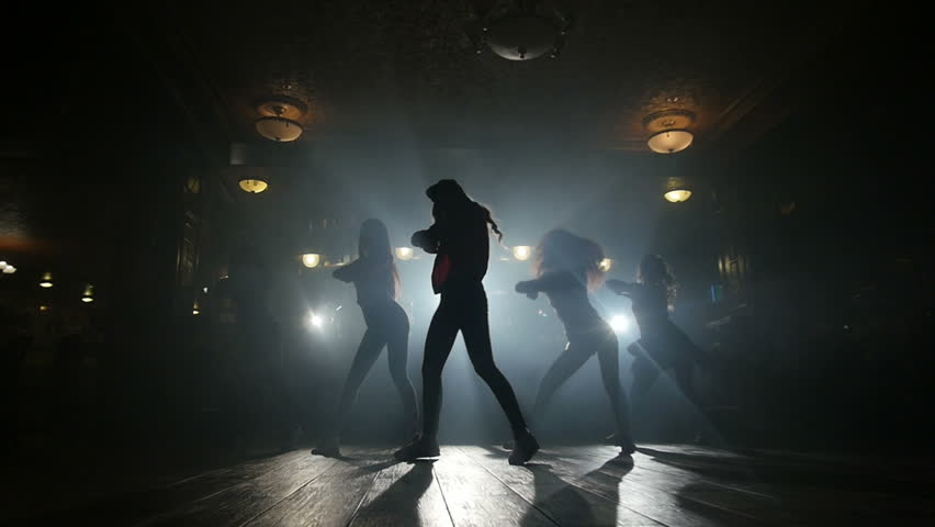 silhouettes of girls dancing, slow motion