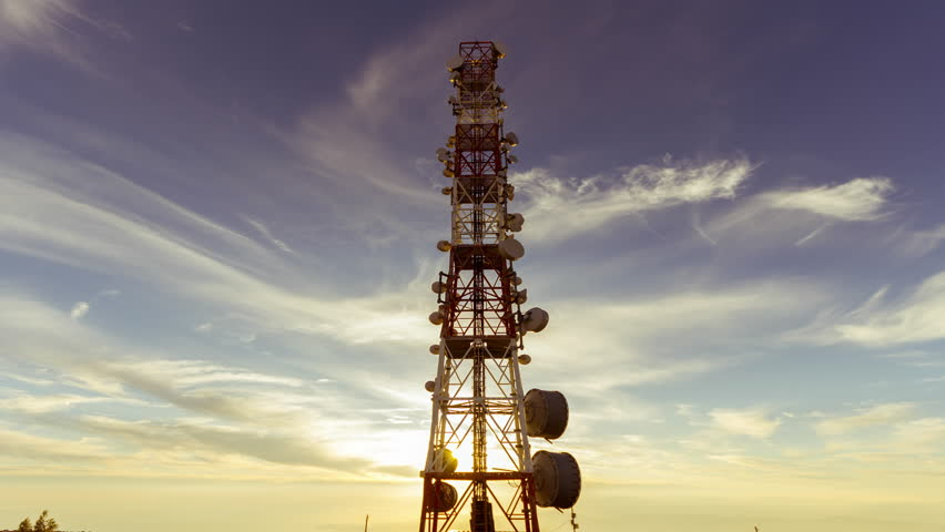 4K 30p communication tower antenna,dusk timelapse.4K, 4096x2304 view, of a cell,broadcast, telecommunication tower/antenna at the the top of a mountain.Timelapse at dusk in warm colours.