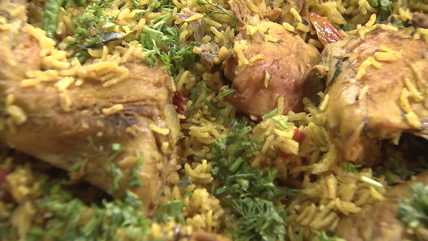 Arabic food cu zoom out shot on a steaming dish of mandi made with arabic food cu zoom out shot on a steaming dish of mandi made with mutton a traditional dish from yemen but popular throughout the gulf stock footage forumfinder Gallery