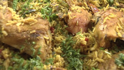 Arabic Food. CU zoom-out shot on a steaming dish of Mandi made with mutton, a traditional dish from Yemen but popular throughout the Gulf.