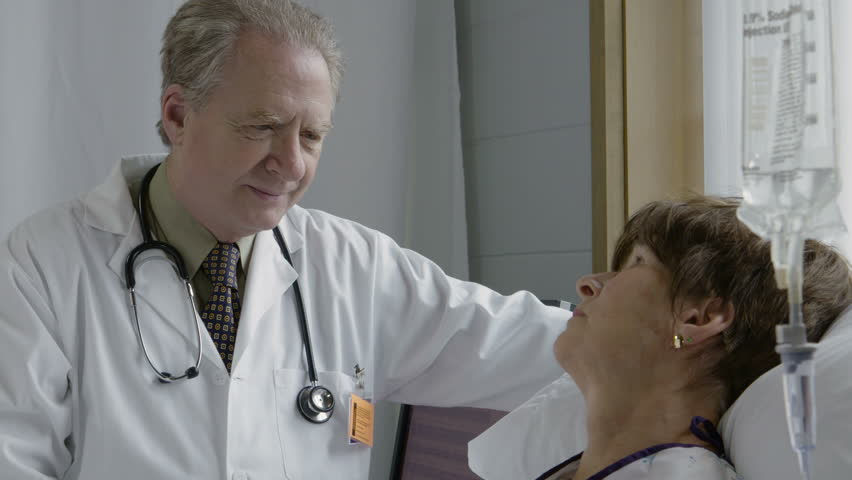 Physician talking with patient, close up | Shutterstock HD Video #16184305