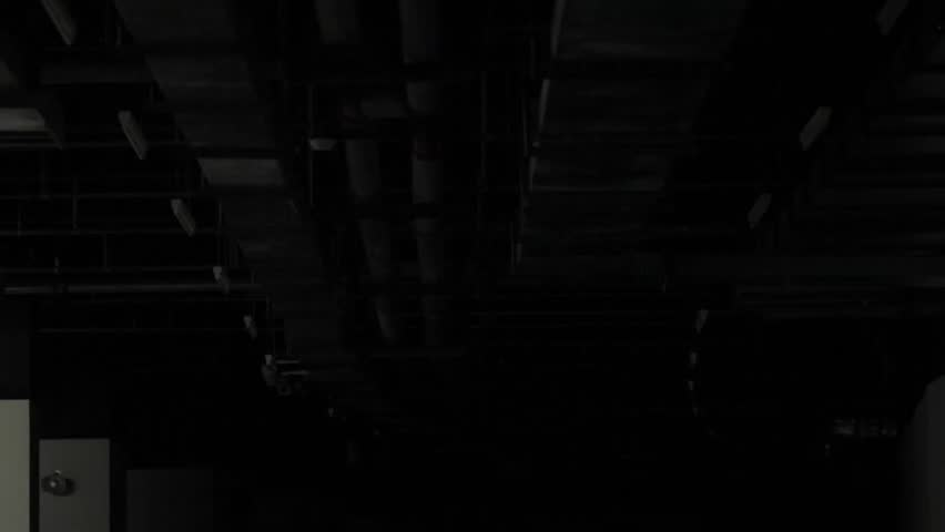 Dark Basement Hd. Medium Long Shot Begins Pitch Black And Then Strip Lights  On The