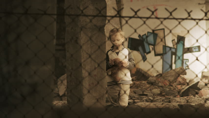 Homelessness. Lonely child in slums. Orphan. Refugee camp. Static shot.