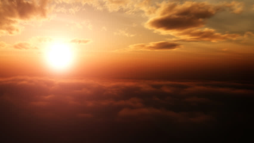Aerial pan shot over clouds during beautiful sunset