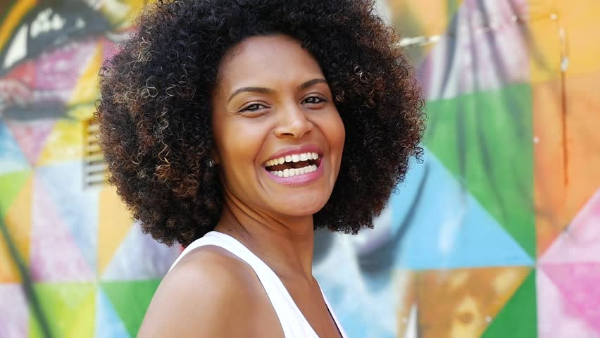 Young Latin Brazilian woman smiling | Shutterstock HD Video #16227865