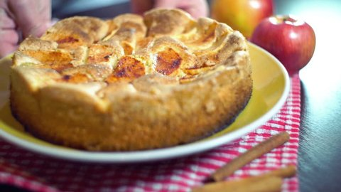 Baked apple pie. Golden colored apple pie with crispy crust. Freshly baked traditional autumn meal. Sweet food made from apples