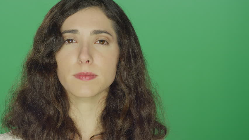 Young brunette woman smiling, on a green screen studio background | Shutterstock HD Video #16253464