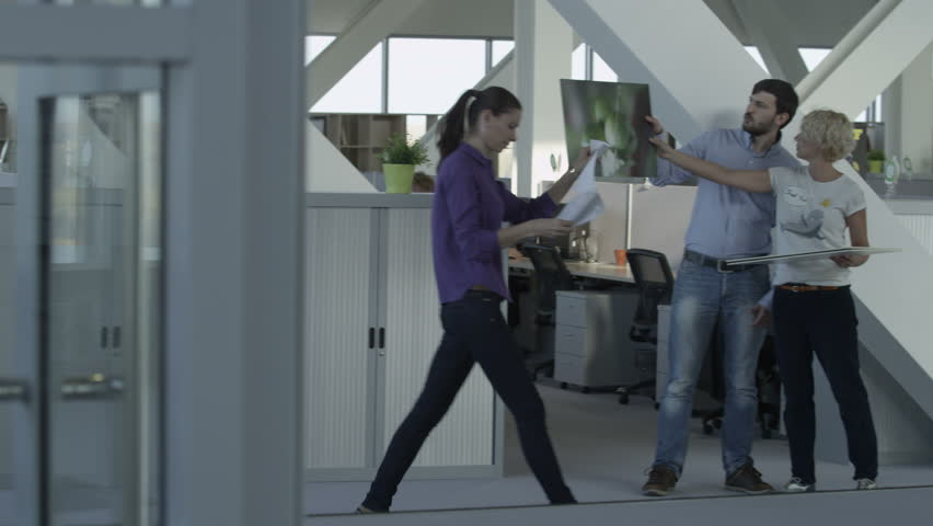 Man and woman, two office employees view drawing and discuss the project | Shutterstock HD Video #16277563