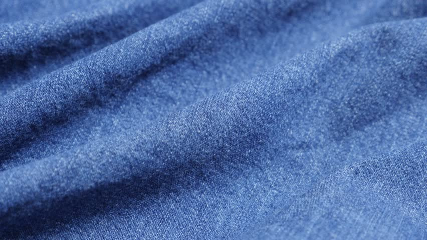 62331f3faea High quality dark blue denim fabric details and texture close-up tilting 4K  2160p 30fps UltraHD video - Jeans dugaree cloth in blue color gathers slow  tilt ...