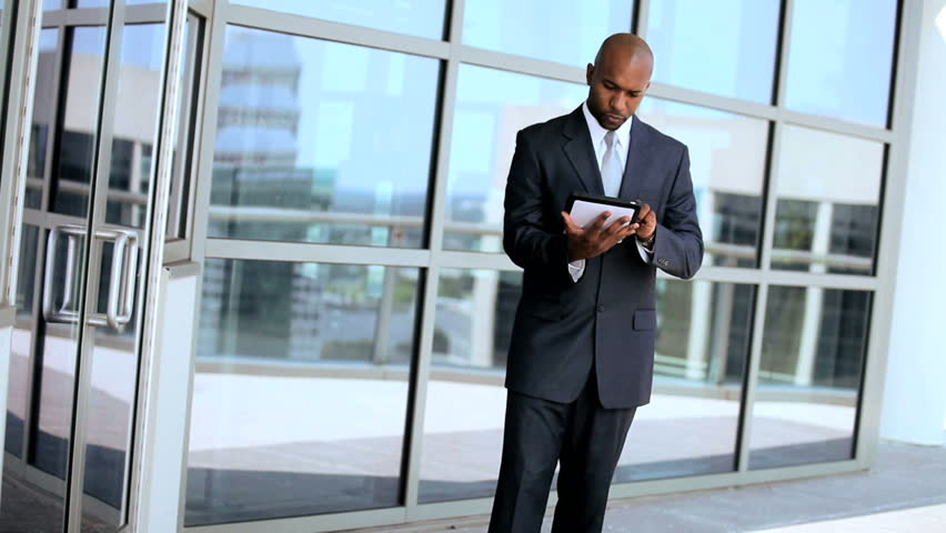 Ambitious Business Executives Using Wireless Tablet Outdoors | Shutterstock HD Video #1630282